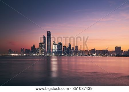 Urban Skyline With Skyscrapers At Beautiful Sunrise. Cityscape Abu Dhabi, United Arab Emirates.