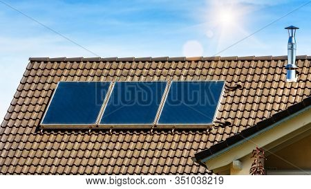 Solar Panel On Residential House Rooftop. Solar System On Roof Of Home Close-up. Blue Solar Cells On