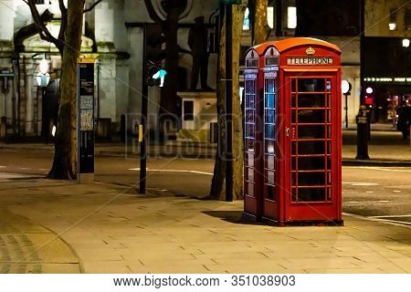London, England, Uk - January 2, 2020: Red Telephone Booth At Night, Red Phone Booth Is One Of The M