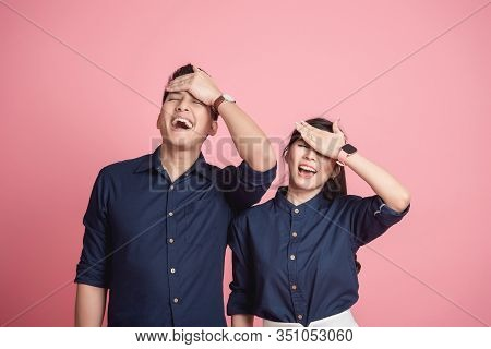 Happy Asian Couple Make Funny Facepalm Gesture