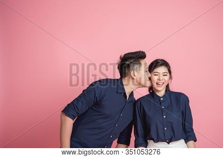 Happy Asian Couple Kissing On Pink Bacground
