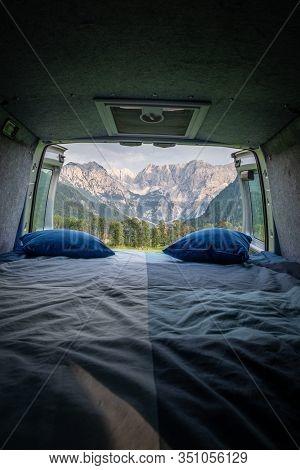 View From Bed In Camper Van To Forest In Zgornje Jezersko And Kamnik-savinja Alps On A Cloudy Summer