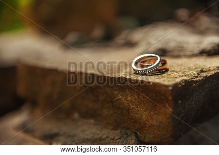 Wedding Rings On Conceptual Dark Stone Background. Bride And Groom Ring In Wedding Day. Decoration F