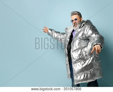Gray-haired, Bearded, Aged Male In Purple Sunglasses, Oversized Silver Colored Down Puffy Jacket, Je