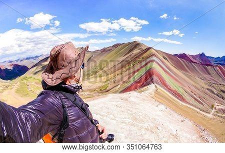 Adventure Traveler Guy Taking Selfie At Rainbow Mountain On Vinicunca Mount During Roadtrip Travel E