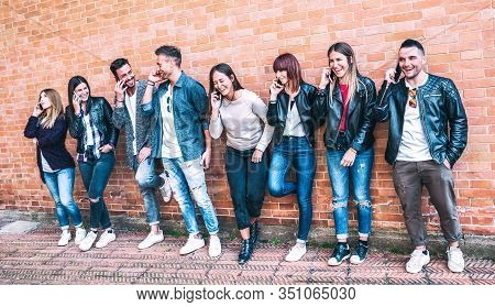 Fashion Millenial Friends Using Smartphone At University College Backyard - Young People Addicted By