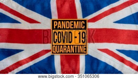Pandemic Sign Warning Of Quarantine Due To Covid-19 Or Corona Virus In The Uk Using A British Flag I