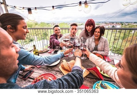 Wide Angle View Of Happy People Toasting Red Wine Together At Rooftop Party In Open Air Villa - Youn