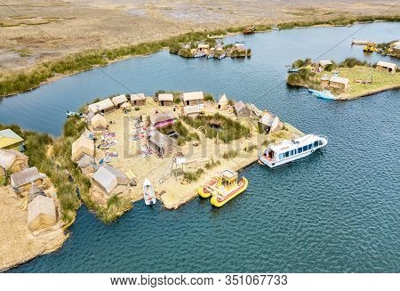 Aerial View Of Floating Village In Uros Islands At Titicaca Lake In Peru - Wanderlust And Travel Con