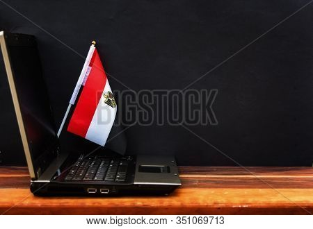 Flag Of Egypt , Computer, Laptop On Table And Dark Background