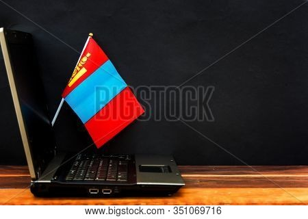 Flag Of Mongolia , Computer, Laptop On Table And Dark Background