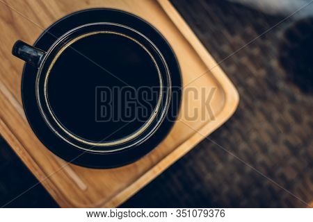 Cinematic Tone Of Top View Coffee Cup On Old Kitchen Table With Copy Space For Your Text.