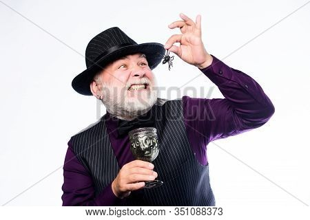 Disgusting Halloween Drink. Elegant Bartender Wear Hat And Vest. Halloween Concept. Add Spider Cockt