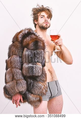 Guy Attractive Rich Posing Fur Coat On Naked Body. Sexy Sleepy Rich Macho Tousled Hair Drink Wine Is