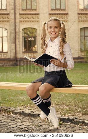 Homeschooling. Vintage Kid Fashion. Small Happy Girl Study Literature. Old School. Back To School. C