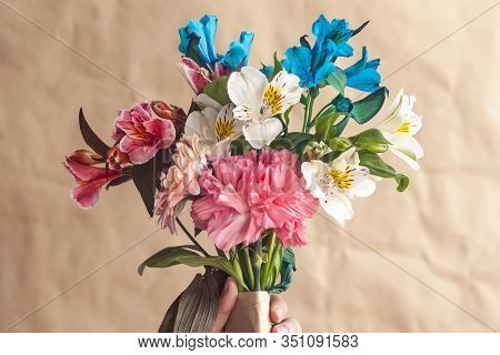Hand Hold Bouquet Of Flowers. Unrecognizable Woman Hands Holding A Beautiful Bouquet Of Colorful Spr