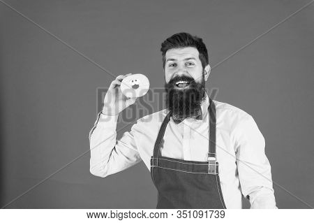We Cook For You. Confident Cook. Professional Cook Holding Doughnut On Red Background. Bearded Man W