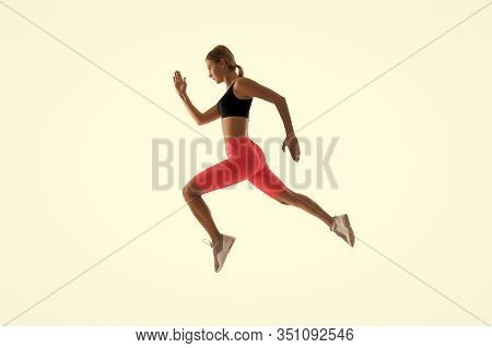 Dynamic Movement. Woman Runner Isolated On White. Jogger Running. Sporty Runner In Fashionable Sport