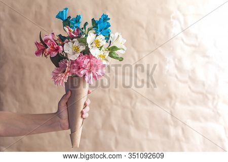 Unrecognizable Woman Hands Holding A Beautiful Bouquet Of Colorful Spring Flowers Against Crafty Bro