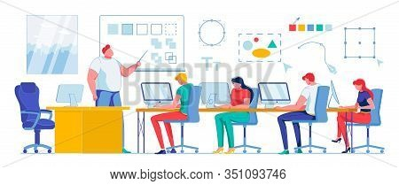 Students Study Classroom Graphic Program, Slide. Guys And Girls Are Sitting At Table And Looking At