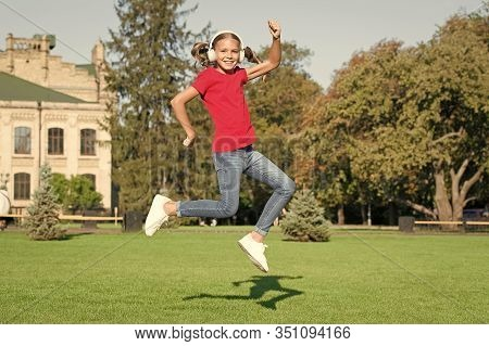 Driving Dancer Excellence. Little Dancer Perform Leap On Green Grass. Cute Girl Dancer Dancing Energ