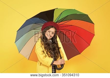 Best Fashion Choice. Happy Child With Fashion Rain Accessory On Yellow Background. Little Girl Hold