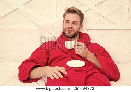 His Favorite Morning Beverage. Handsome Guy In Bathrobe Holding Cup Of Hot Drink. Bearded Caucasian