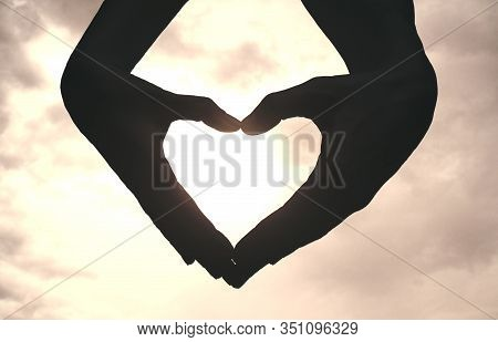 Hands Showing Heart Against The Sky. Close Up