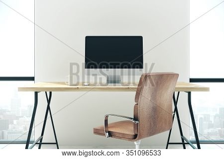 Concrete Office Interior With Empty Computer Screen On Desk, Chair, Coffee Cup And Panoramic City Vi