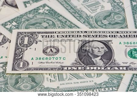 Close Up Of One Dollar Bills, One Is Lying In The Center