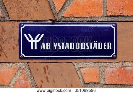 Ystad, Sweden - April 15, 2017: The Property Owner Ab Ystadbostader Sign Attached On Red Brick Wall.
