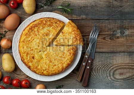 Spanish Omelette With Potatoes And Onion, Typical Spanish Cuisine. Tortilla Espanola. Rustic Dark Ba