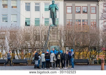 Reykjavik Iceland - November 1. 2019: Tourists With A Guide In Front Of The Statue Of Jon Sigurdsson