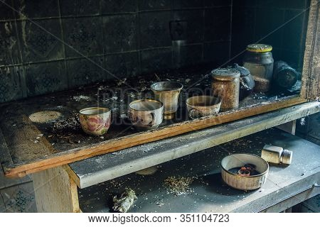 Burnt Room Interior. Burnt Still Life. Charred Wall, Cups In Black Soot