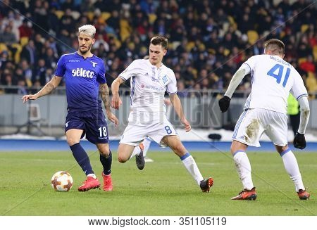 Kyiv, Ukraine - March 15, 2018: Luis Alberto Of Ss Lazio (l) Fights For A Ball With Volodymyr Shepel