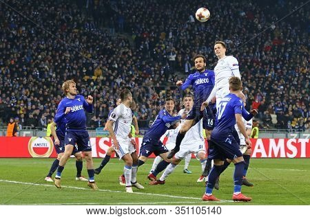 Kyiv, Ukraine - March 15, 2018: Fc Dynamo Kyiv (in White) And Ss Lazio (in Blue) Players Fight For A