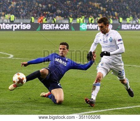 Kyiv, Ukraine - March 15, 2018: Luiz Felipe Ramos Of Ss Lazio (l) Fights For A Ball With Josip Pivar