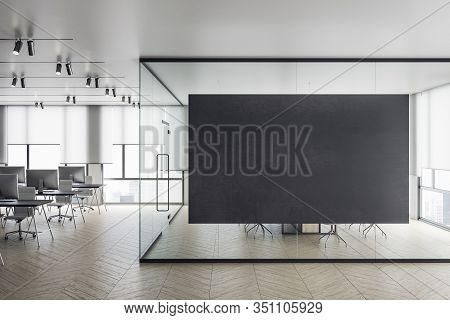 Contemporary White Office With Computer On Desk And Blank Billboard. Workpace Concept. Mock Up, 3d R