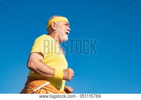 Best Cardio Workout. Senior Sportsman Jogging Outdoors And Enjoying Sunny Day. Freedom Retirement Co