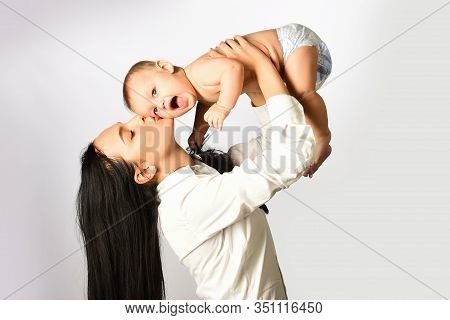 Happy Family. Mother Holding Small Child. Family Concept. Woman Playing With Her Baby. Happy Smiling