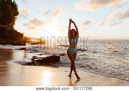 Beautiful And Fashion Young Woman Outfit Posing At Beach. Female Silhouette In The Sunset On The Bea