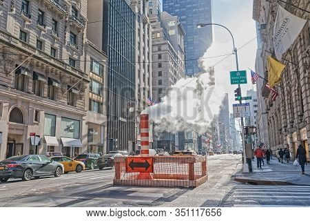 New York, Usa - January 15, 2018: Steam Vapor Being Vented Through A Typical Con Edison Orange And W