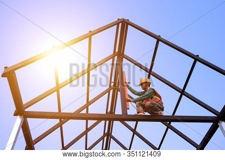 Roof Technician Roofing Makers Work With The Roof Structure Of A Building On A Construction Site. Ro