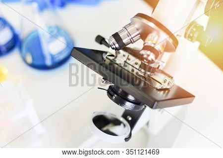 Microscope In Modern Lab For Scientist Research Or Medical / Microscope With Metal Lens At Laborator