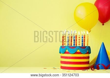 Colorful birthday party background with birthday cake and balloons