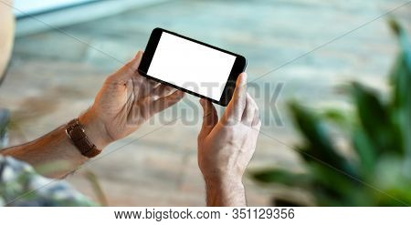 Mock up of a smart phone in male hands. Clipping path included.
