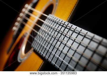 Acoustic guitar fretboard frets strings and sound hole