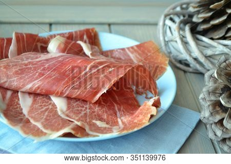 Lomo Thin Pieces Of Cured Marbled Meats.