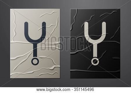 White Musical Tuning Fork For Tuning Musical Instruments Icon Isolated On Crumpled Paper Background.