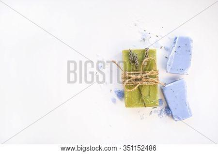 Homemade Lavender, Olive Soap Bars And Lavender Flowers On White Background With Copyspace.